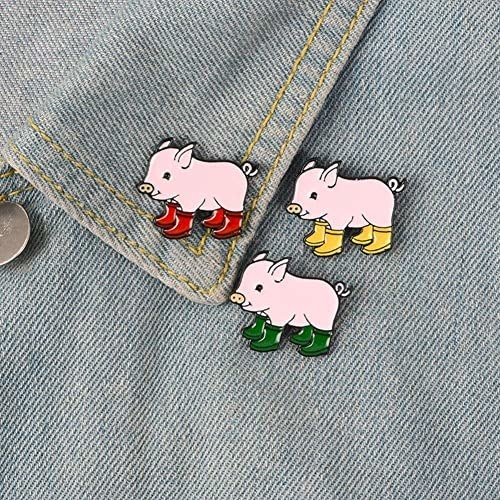 denim lapel with three enamel pins of pigs wearing colorful rainboots