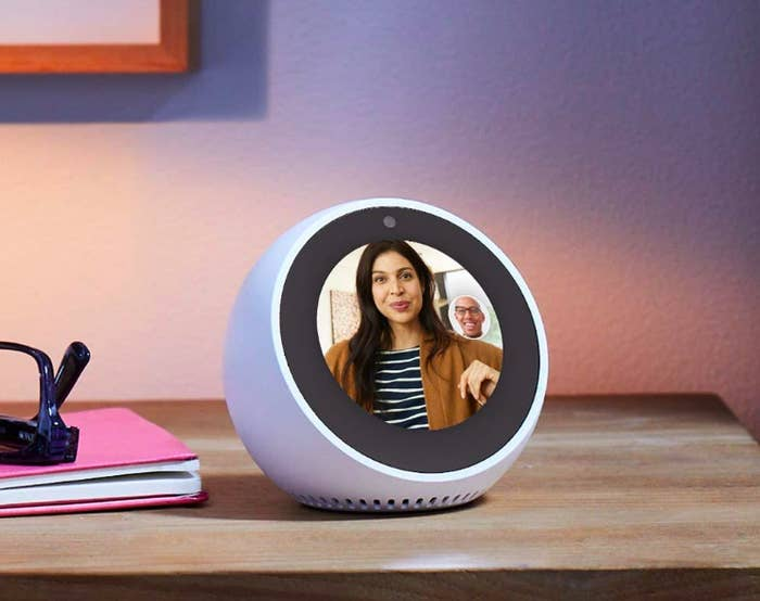 A lifestyle shot of the Echo Spot with a video chat displayed on the screen