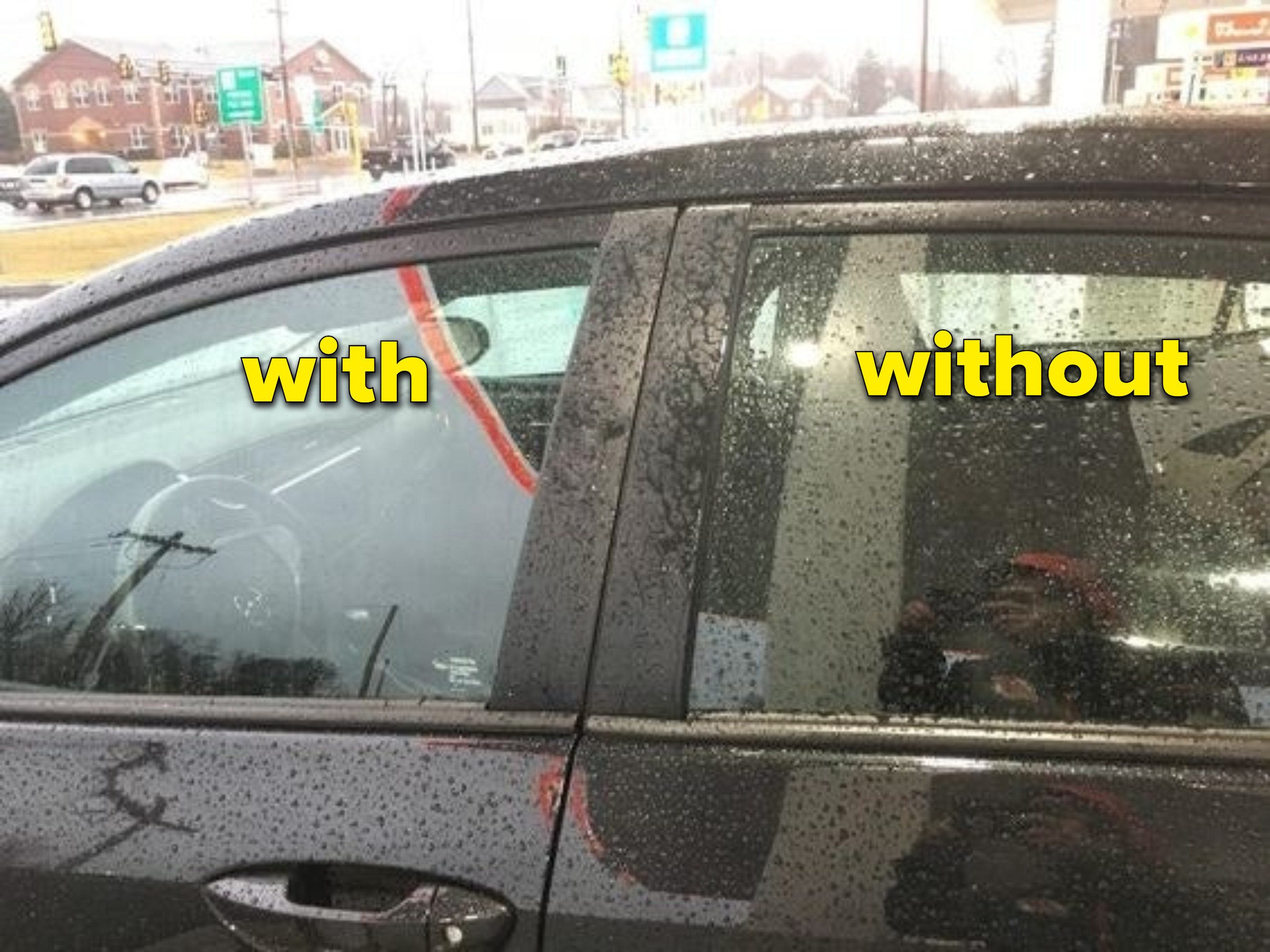 Reviewer's car to show how one window is clear, while the other untreated window is covered in raindrops