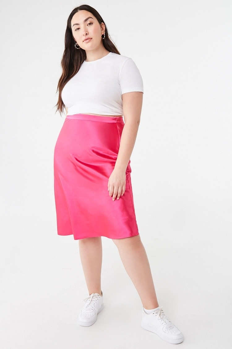 Model wearing the skirt with a high-rise waist in pink