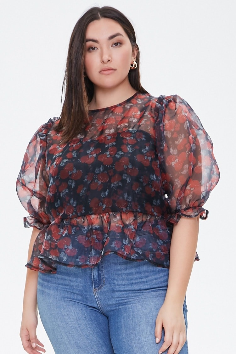 Model wearing the top with a knit bodice lining, 3/4 balloon sleeves that have a ruffle detailing on the shoulders and cuffs, and elastic waist with flounce hem