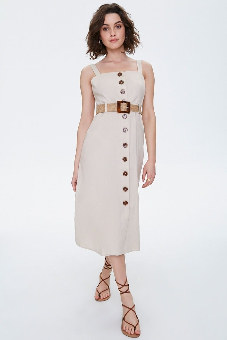 Model wearing dress with buttons down the front center and removable jute belt with square buckle