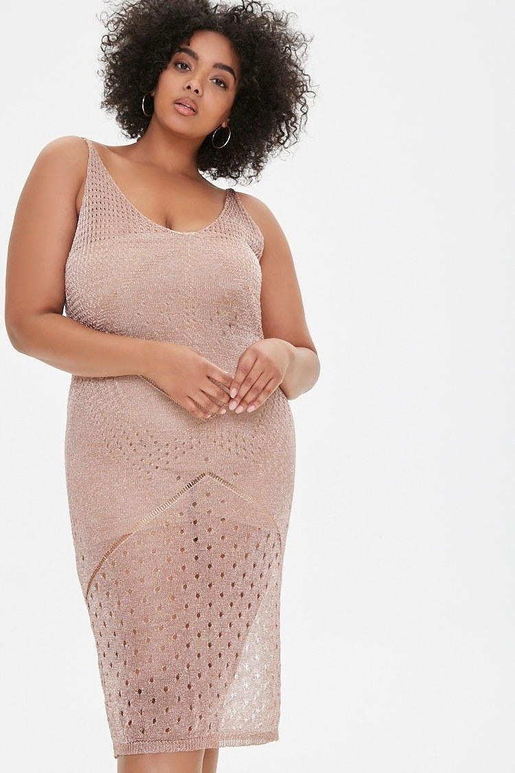 An open-knit blush midi dress with a v-neck, rolled shoulder straps, and a pointelle and geo-stitched detail throughout