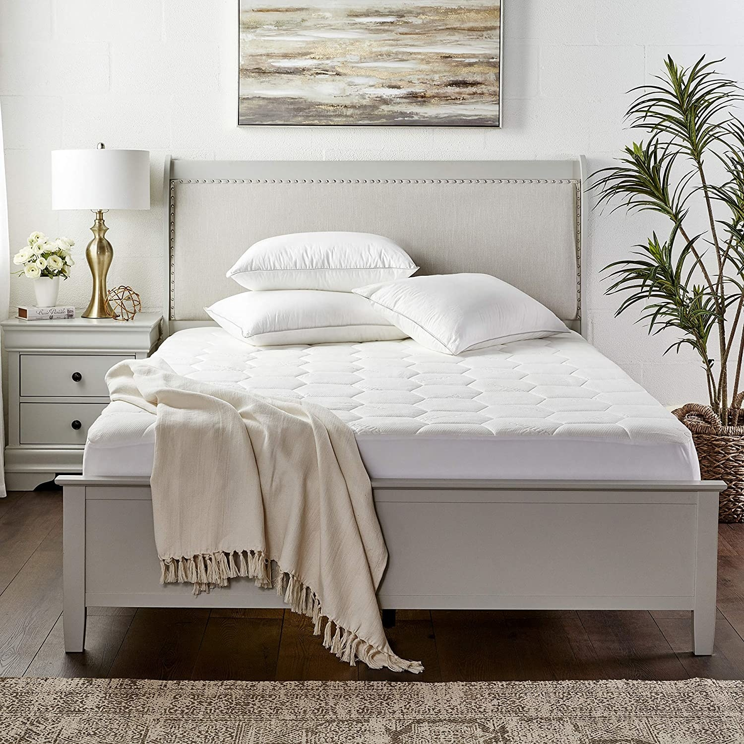 The pad on a mattress, staged in a room
