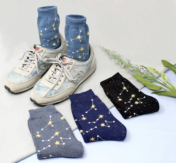 The mid-height socks in light blue, gray, dark blue, and black