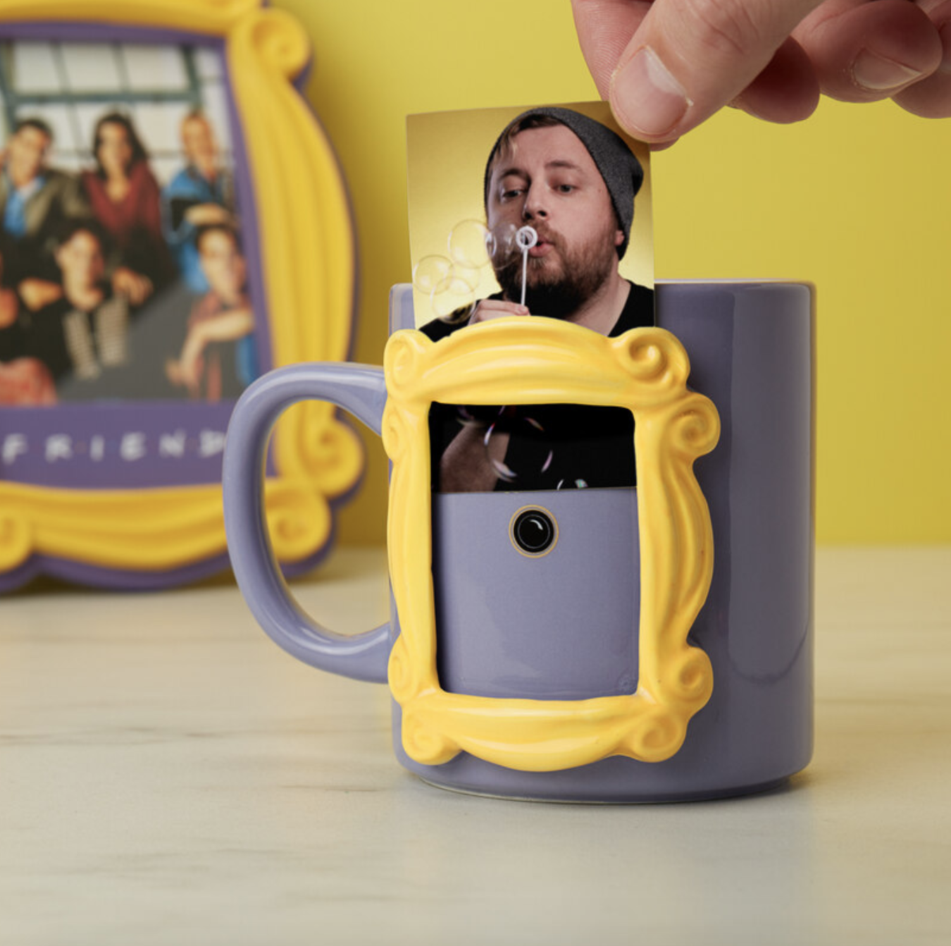 A photo frame mug shaped like the famous purple doorway from Friends.