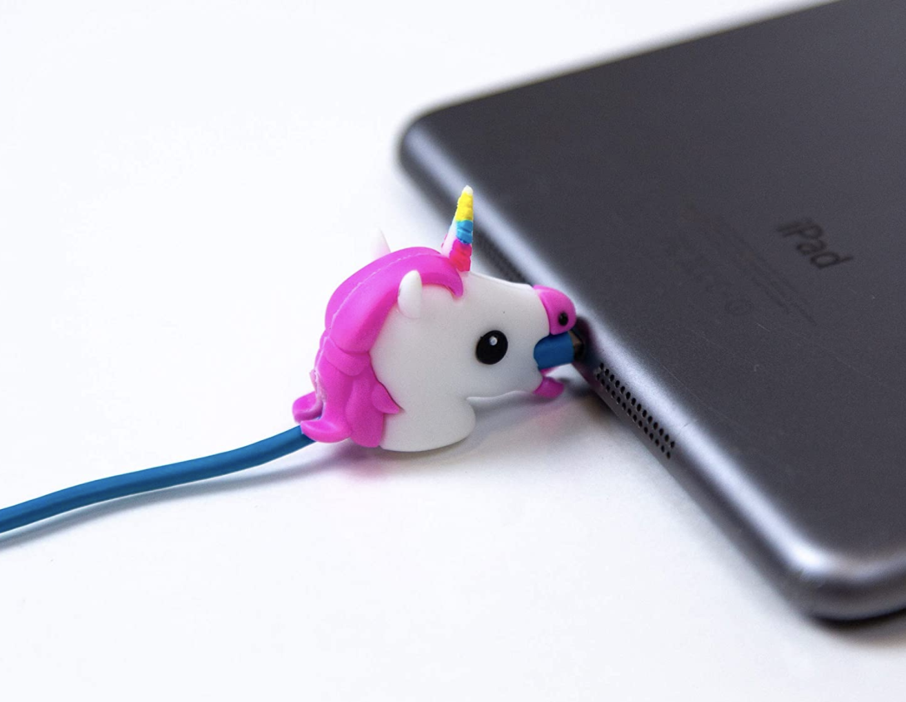 A unicorn cable bite plugged into the side of a laptop