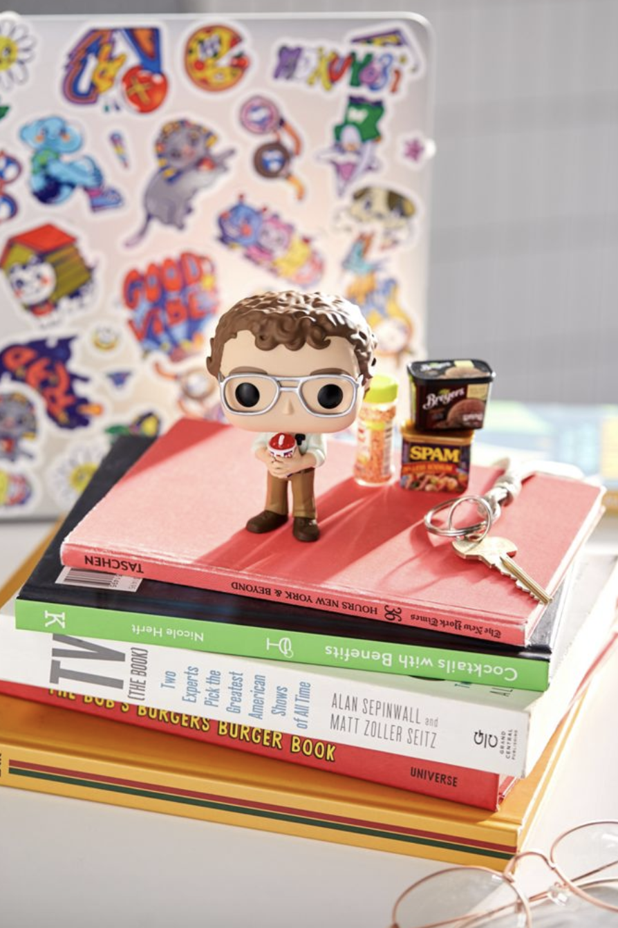 """Alexei """"Stranger Things"""" Funko Pop! Figure on top of a book pile"""