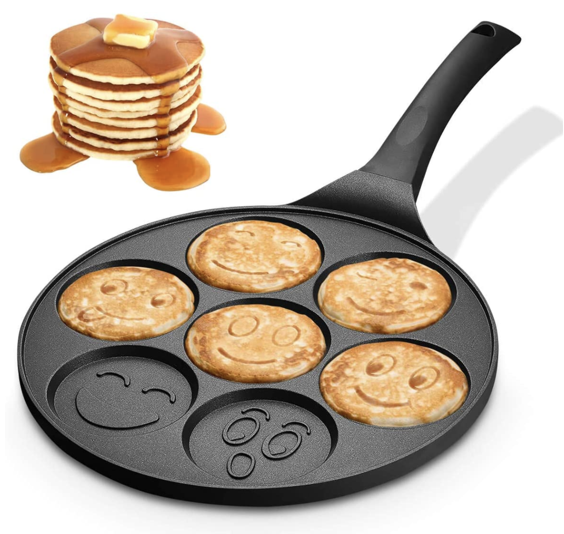 An emoji pancake pan with smiley and winking faces