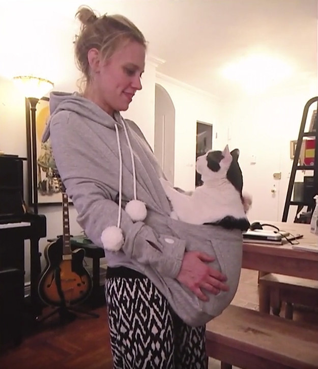 Kate holding her cat inside her hoodie