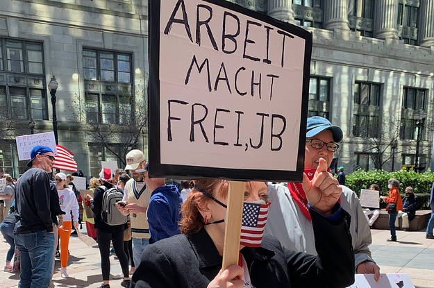 A Woman At An Anti-Lockdown Protest Held A Sign From A Nazi Concentration Camp