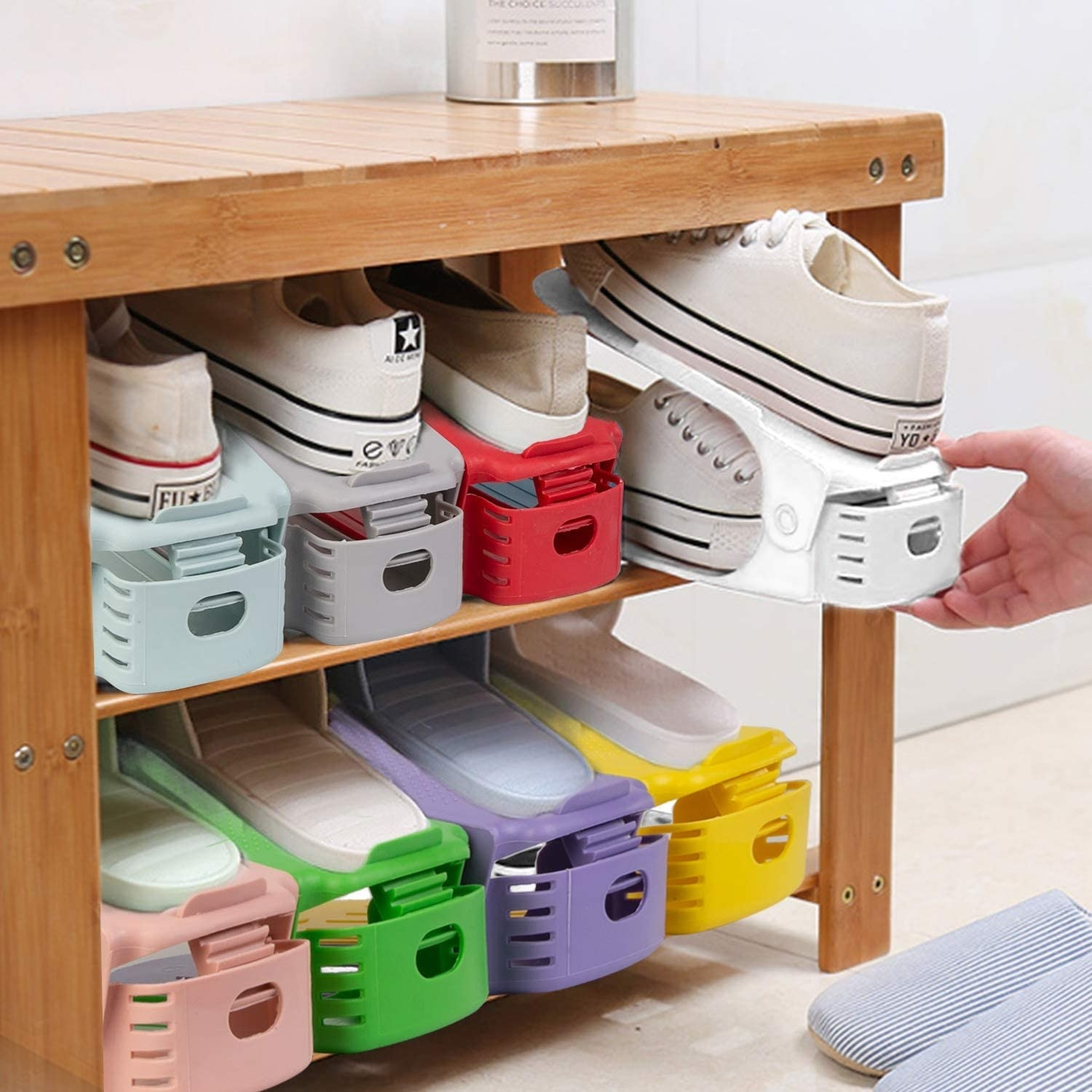colorful shoe organisers that stack shoes on top of each other so each pair is the width of one pair