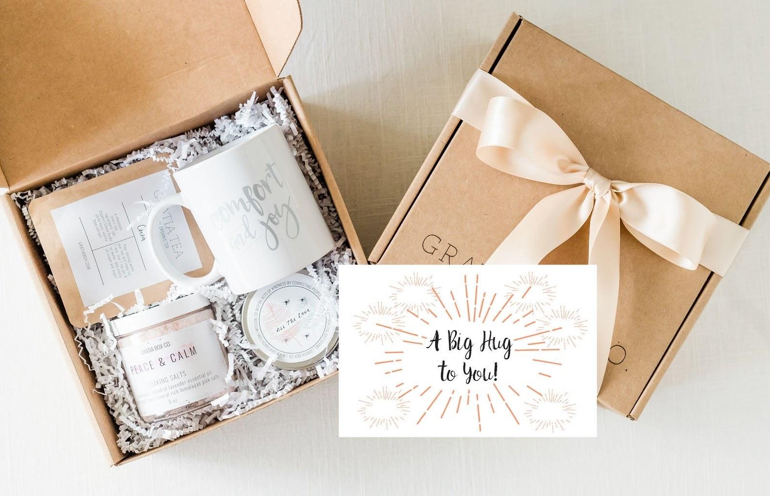 gift box open with mug, scrub, and tea