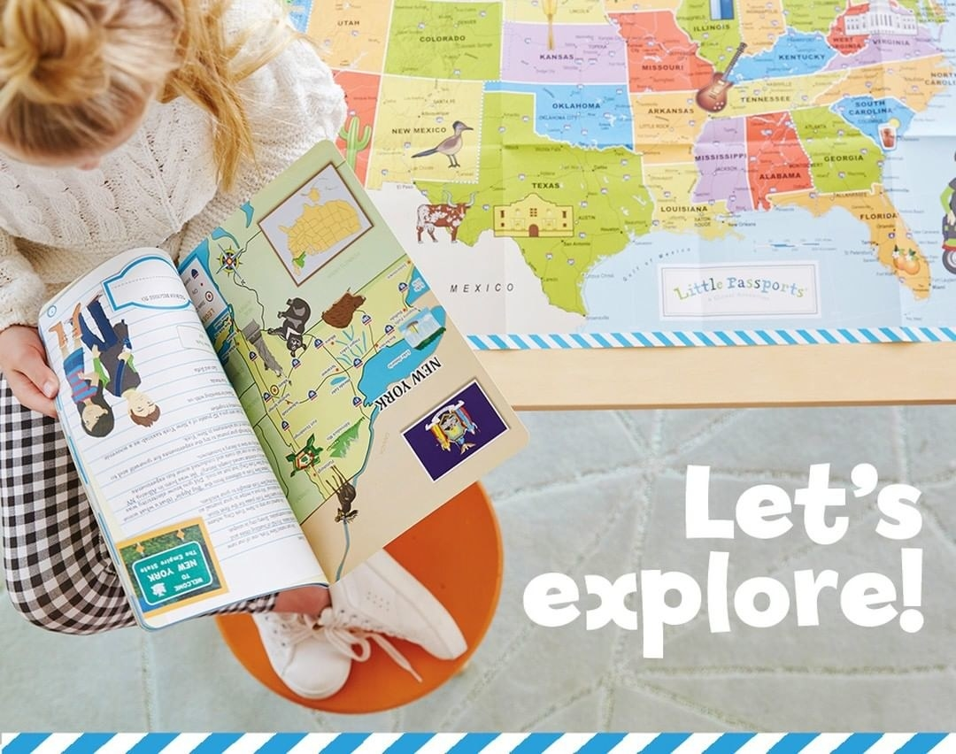 A child model reading a world-explore book with a map of the United States behind them