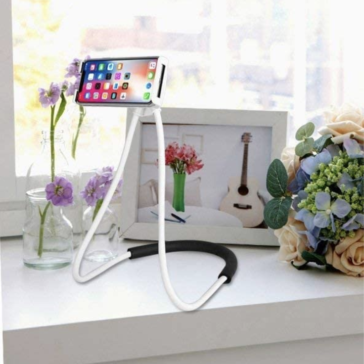 Neck mount standing on a table to be used as a stand