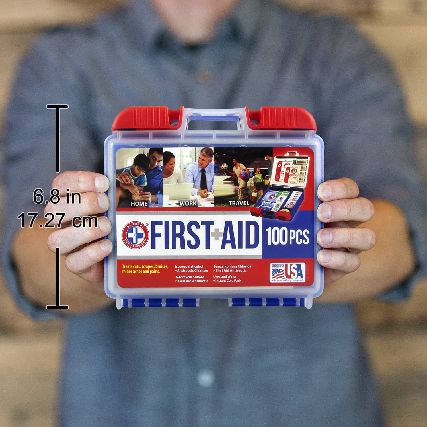 Model presenting First Aid kit in red, white, and blue plastic box