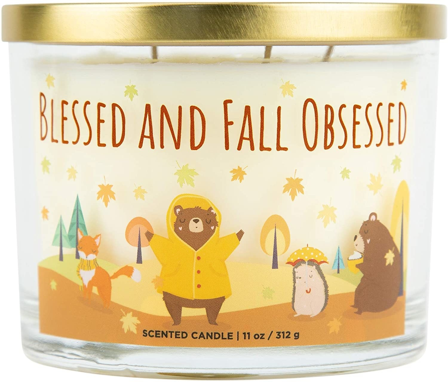 "candle with illustrations of woodland creatures with caption ""blessed and fall obsessed"""