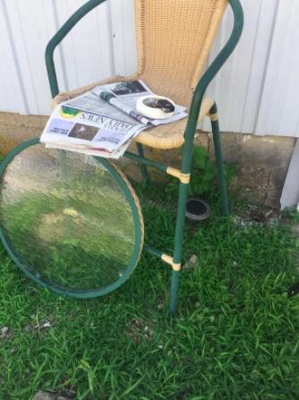 before of patio chair with green metal accents