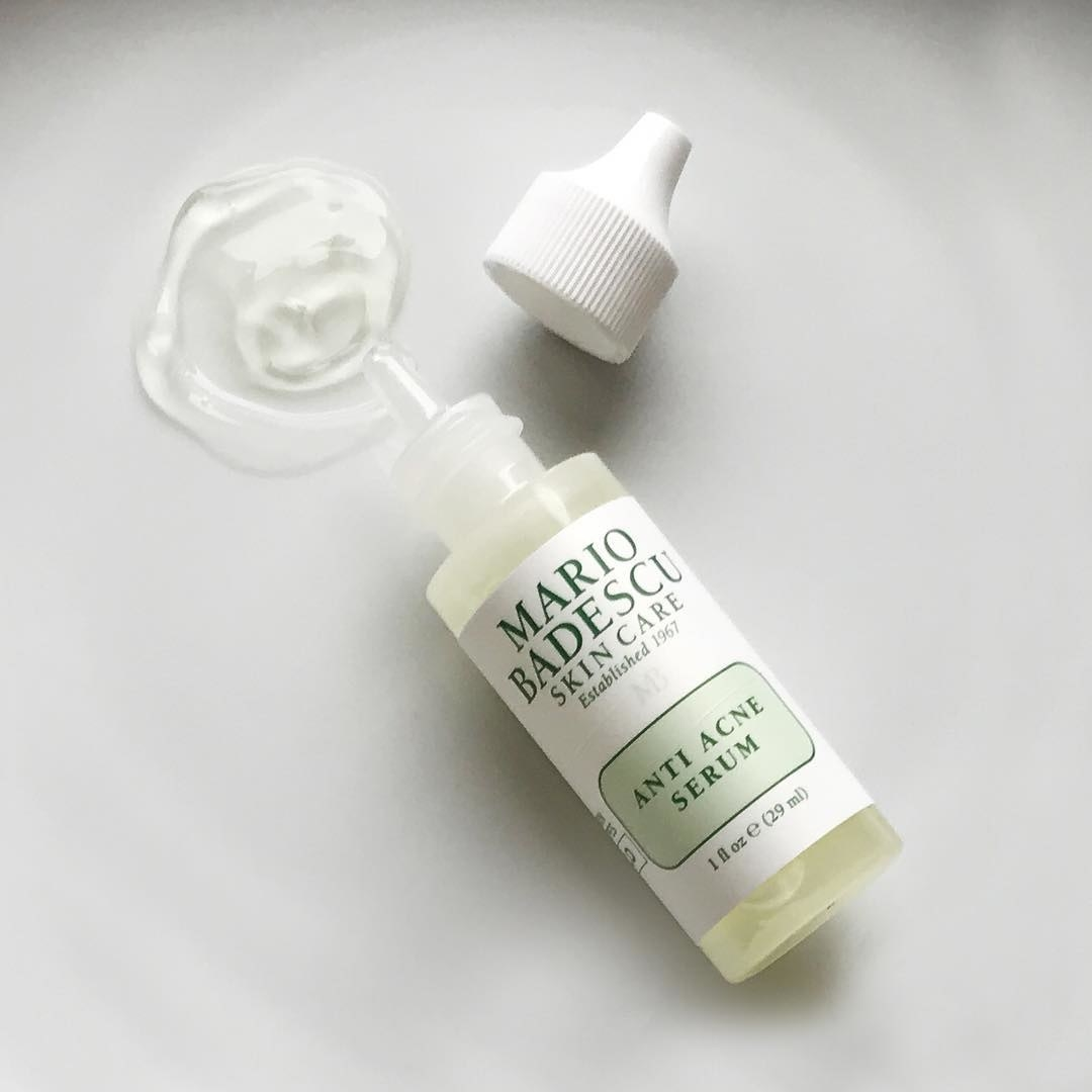 """small light green bottle with clear nozzle labeled """"Mario Badescu Skin Care Anti Acne Serum"""" with white cap"""