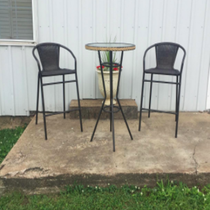 reviewer's after pic of refreshed outdoor furniture
