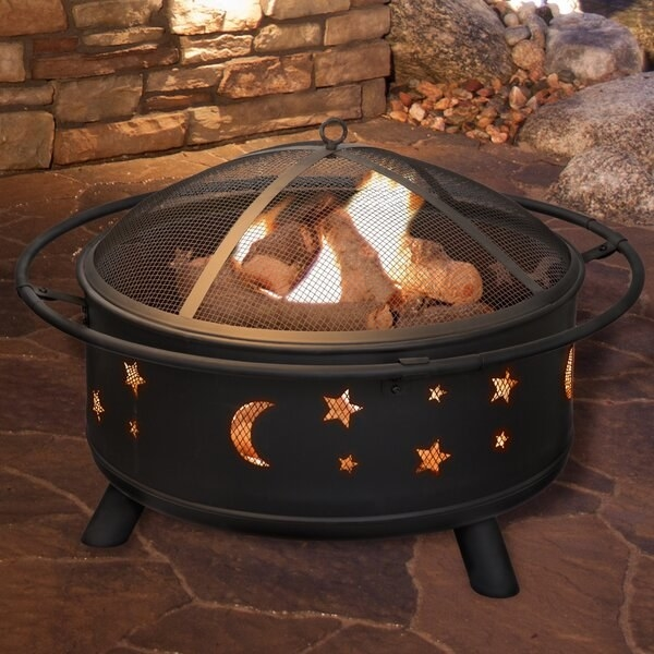 round low fire pit with stars and moons cutouts on the side