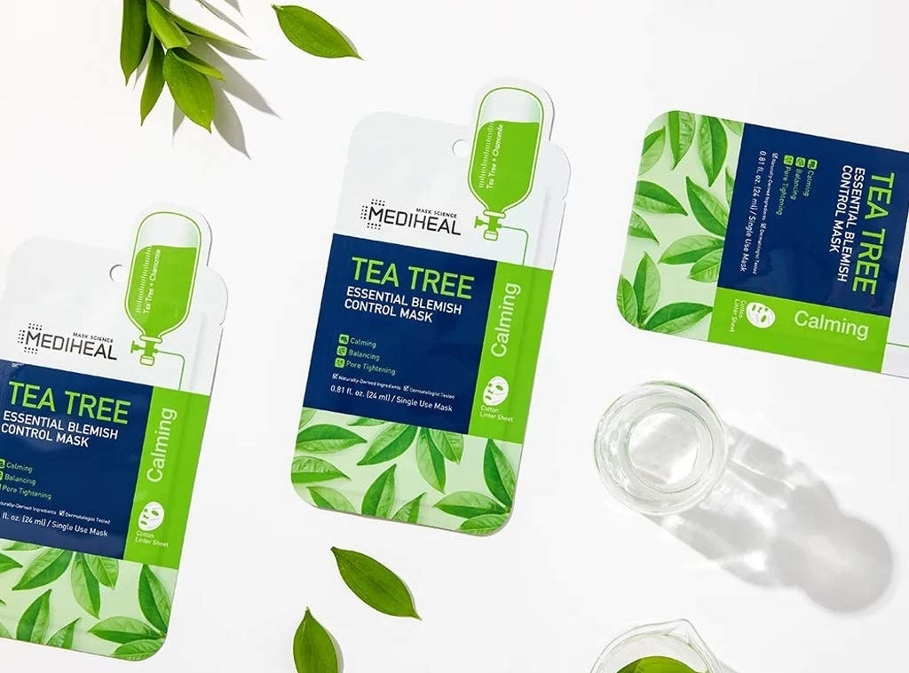 """three green, blue, and white mask packets labeled """"Mediheal tea tree essential blemish control mask"""""""