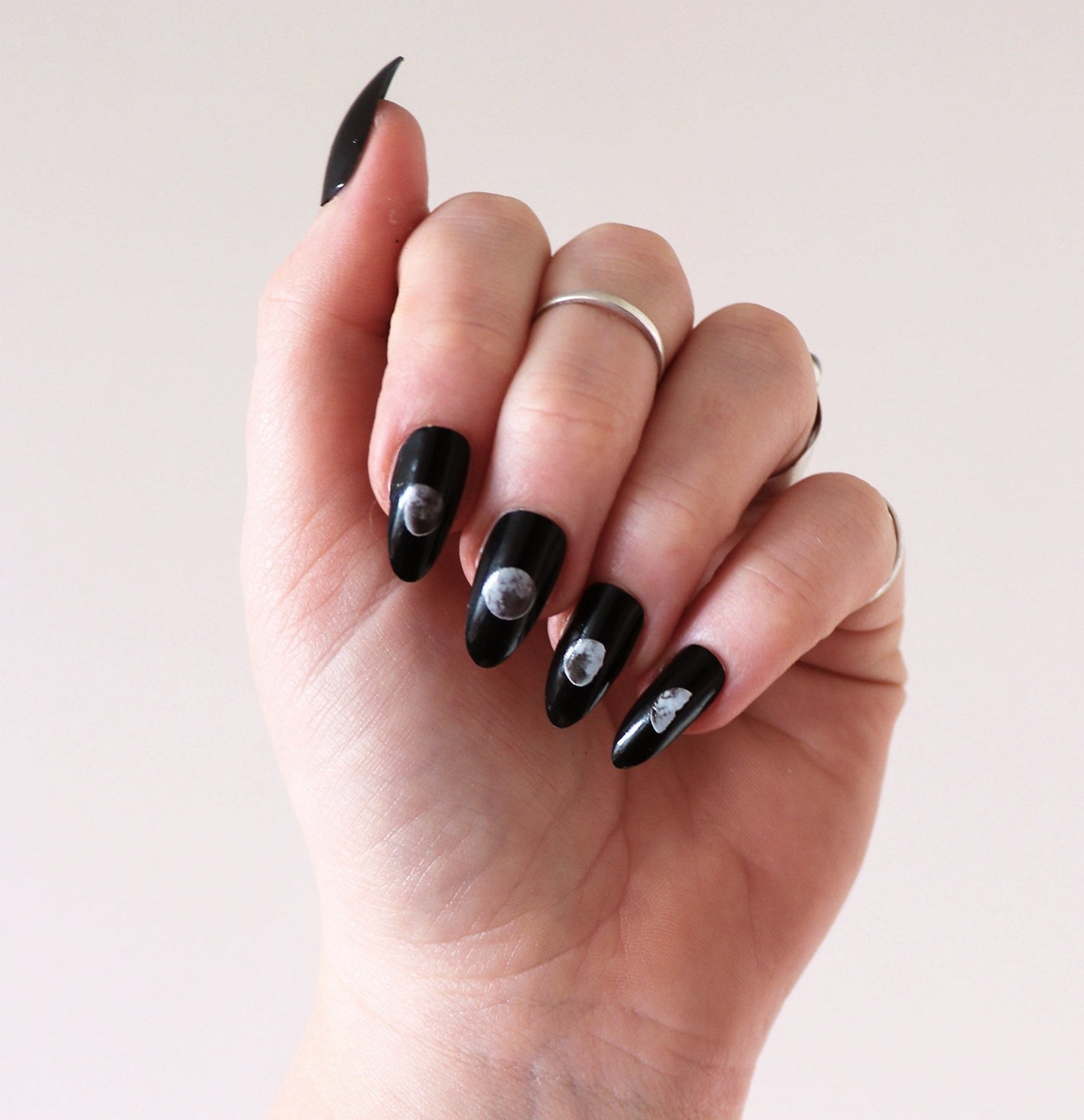 Model wearing the lunar eclipse nail stickers