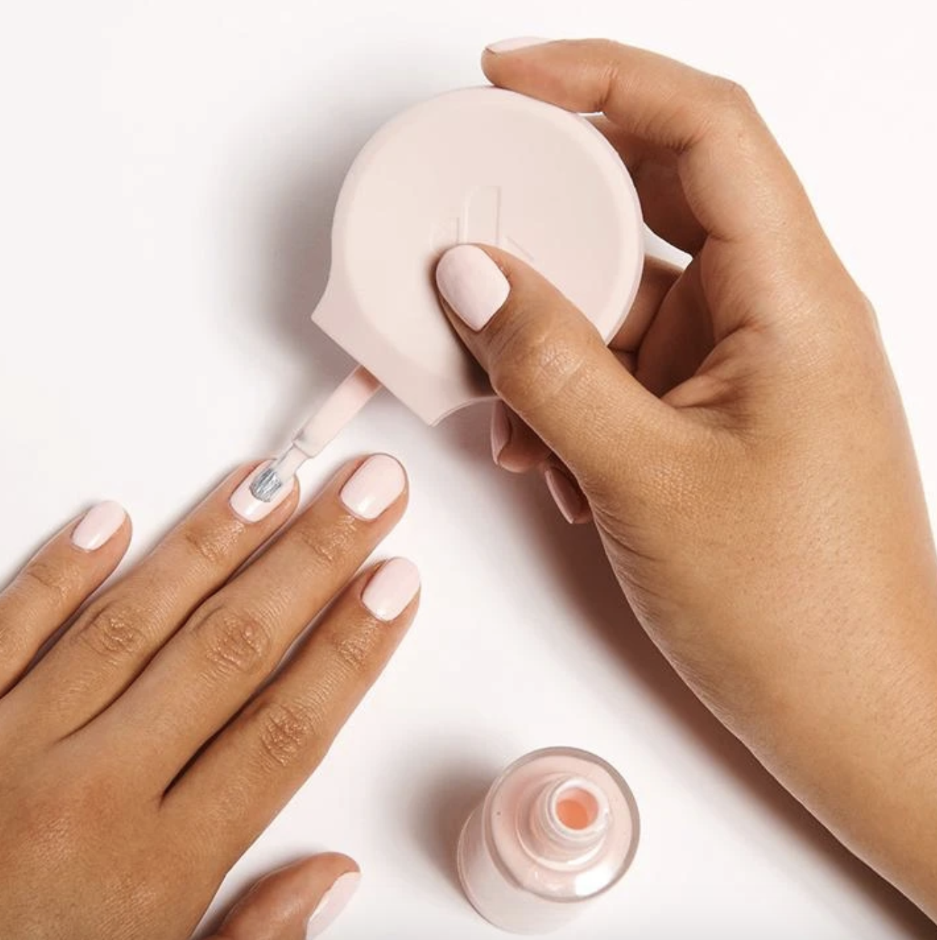 model painting nails using the pink universal grip