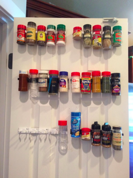 Spices mounted on backside of pantry door