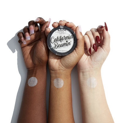 three forearms of people with dark, medium, and fair skin tones with the silver highlighter swatched on the wrists to show the pigmentation