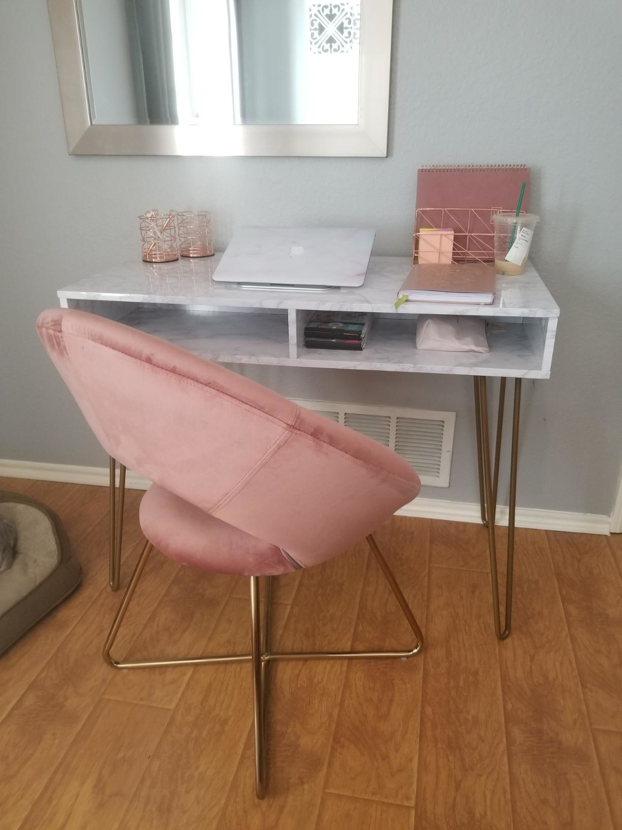 A reviewer's chair next to a desk