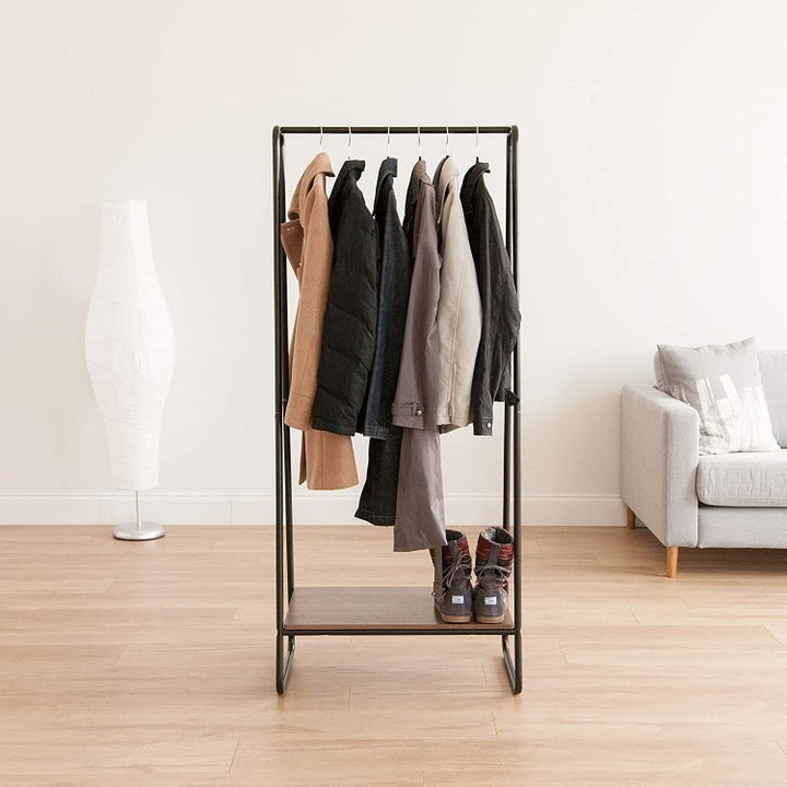 A garment rack with clothes