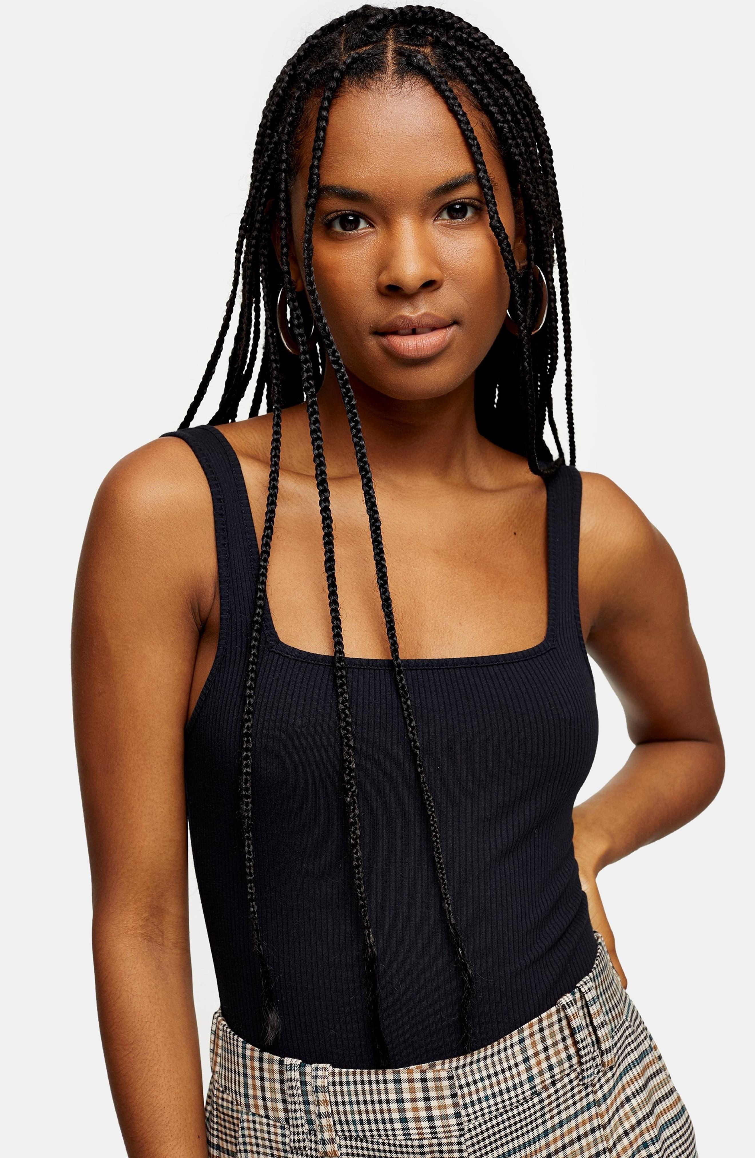 Model wearing the bodysuit in black