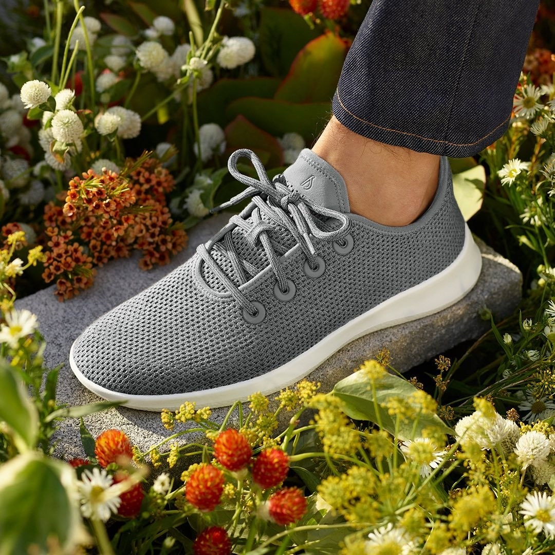 model wearing the knit lace-up sneaker in grey with white sole