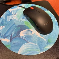 Round mouse pad with blue watercolor brush mark design