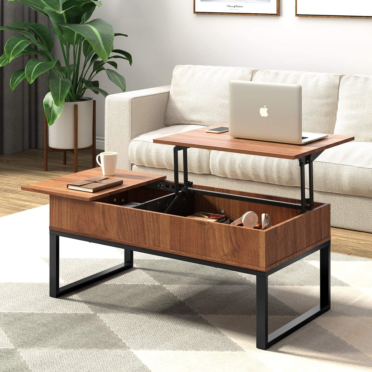 The minimalist coffee table is made with square metal legs and a wood top. The top of the table can be lifted and turned into an upright desk with storage beneath.