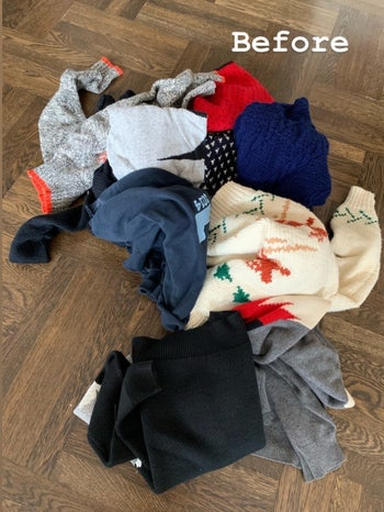 BuzzFeed Shopping reviewer's before picture of a pile of sweaters
