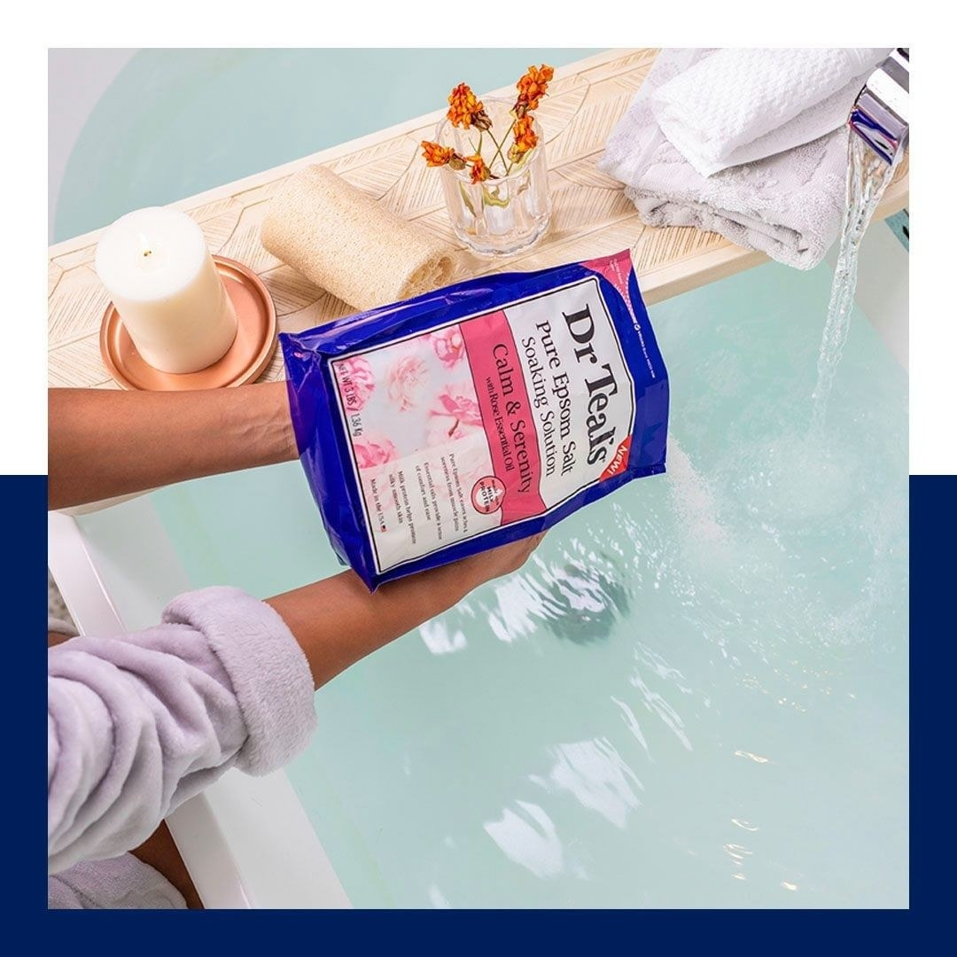 a bag of dr. teal's pure epsom salt being poured into a tub