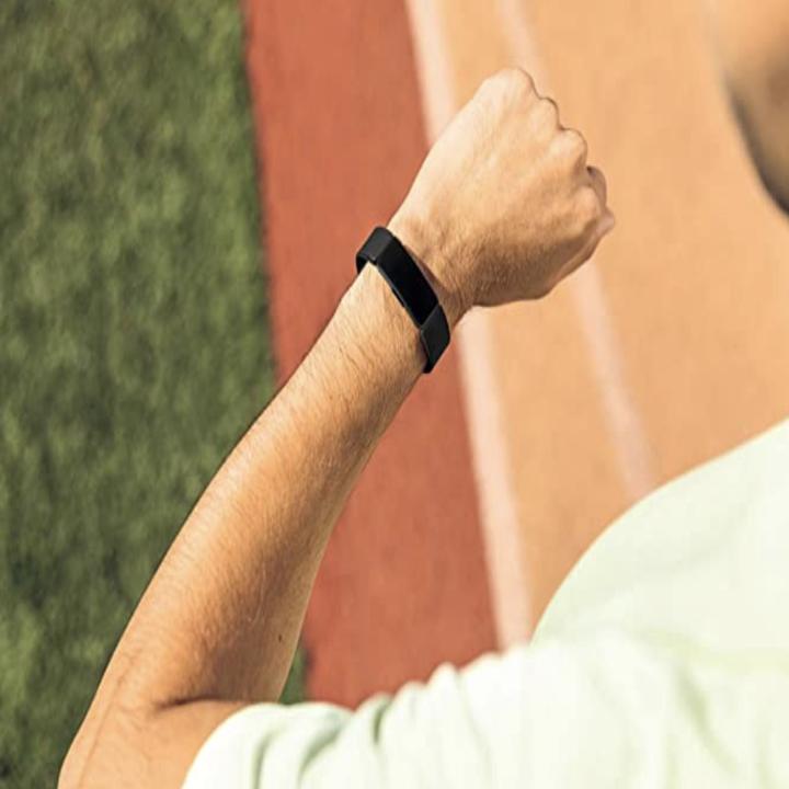 model wears black Fitbit Inspire HR on their wrist