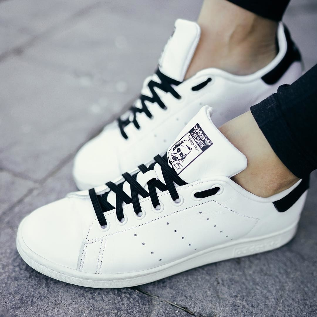 A pair of Adidas with tie-free shoelaces on them