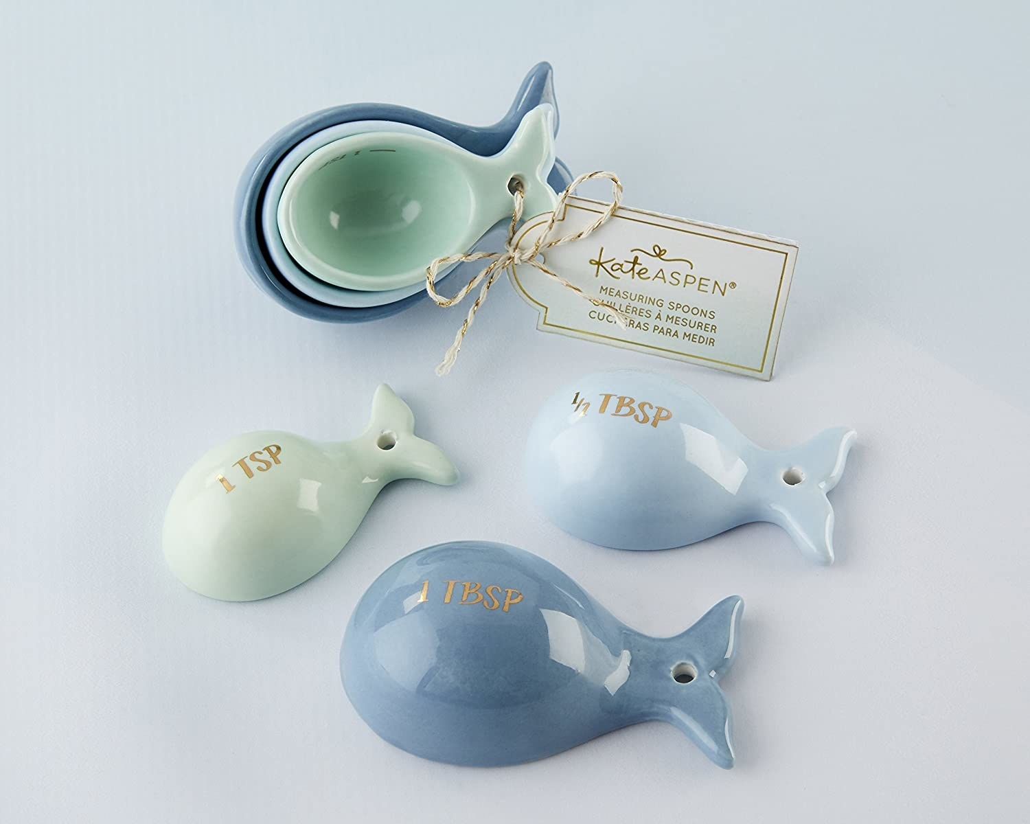 Three ceramic measuring spoons in the shape of tiny whales