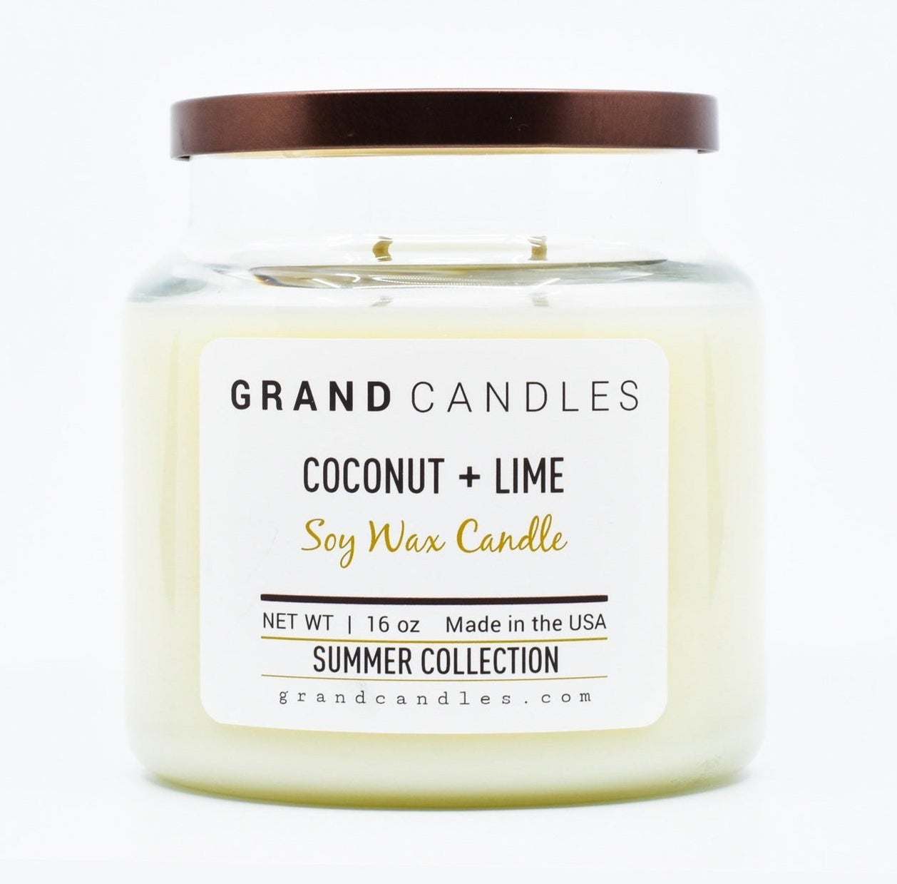 "candle in clear jar with brown lid labeled ""Grand Candles coconut + lime"""
