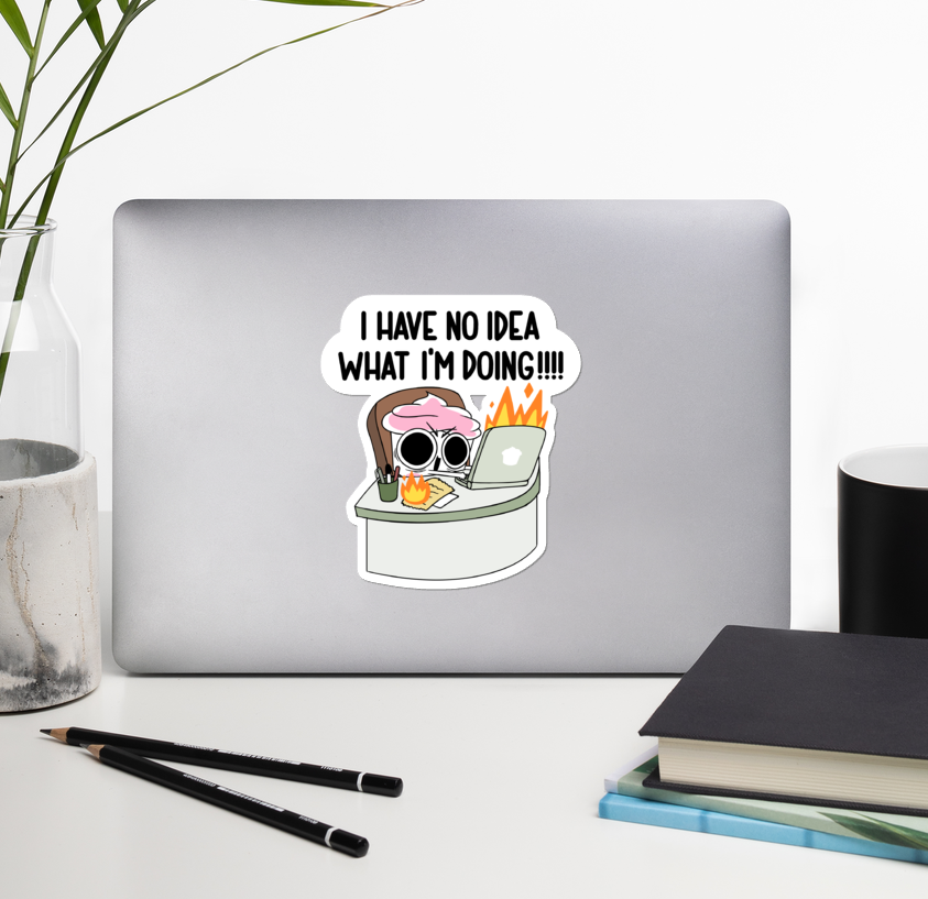 "A large sticker of The Good Advice Cupcake sitting at a desk on her computer, which is on fire, as are her notes. Her eyes are wide and she's yelling ""I HAVE NO IDEA WHAT I'M DOING!!!!"""
