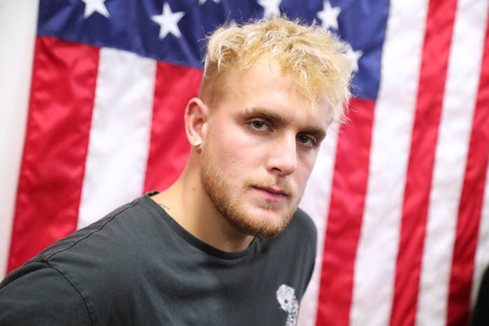 YouTube star Jake Paul in front of a United States flag.