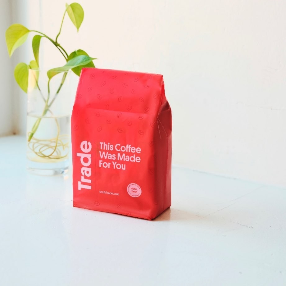 """Red coffee bag with the words """"Trade"""" and """"This Coffee Was Made For You"""" on it"""