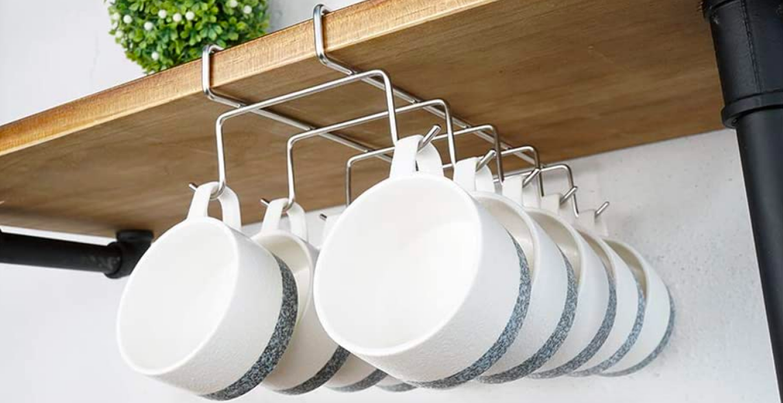 A product shot showing 10 short mugs hanging from the bottom of a shelf