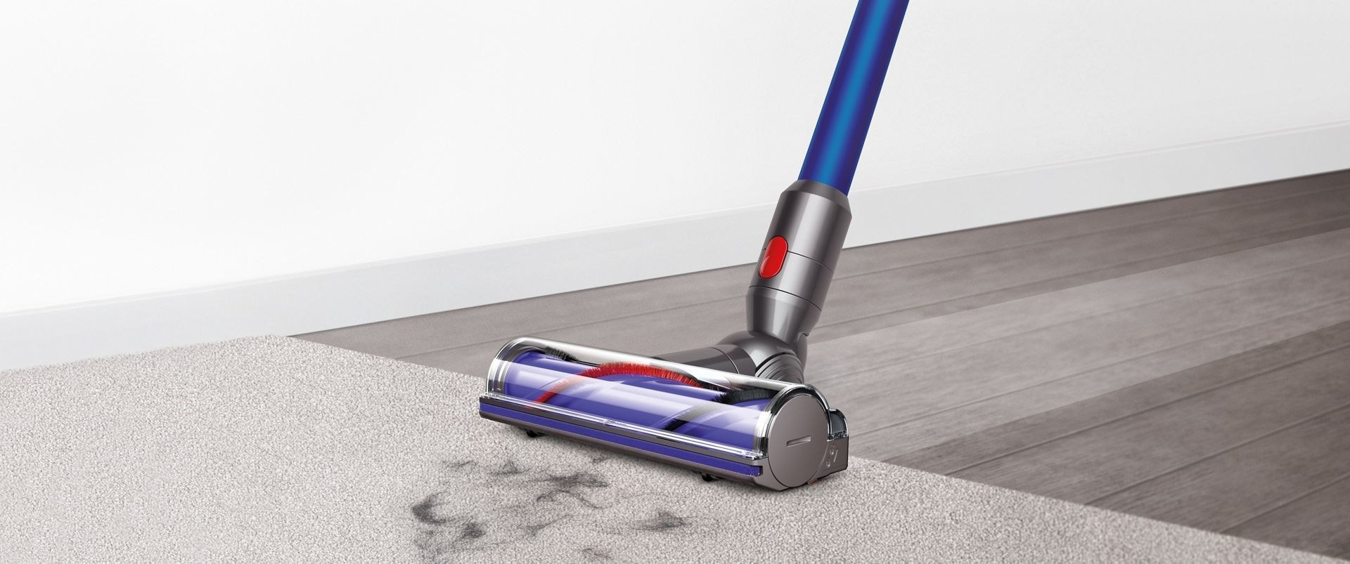 a vacuum cleaner sucking up pet hair from a rug