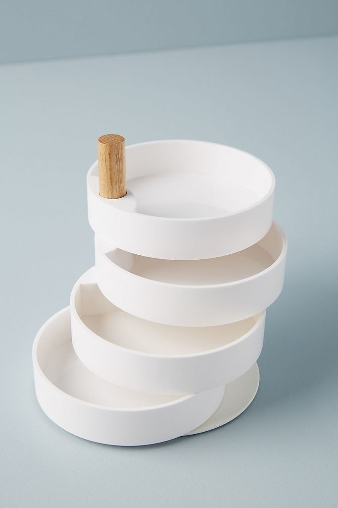A product shot of an empty jewelry dish with four adjustable dishes