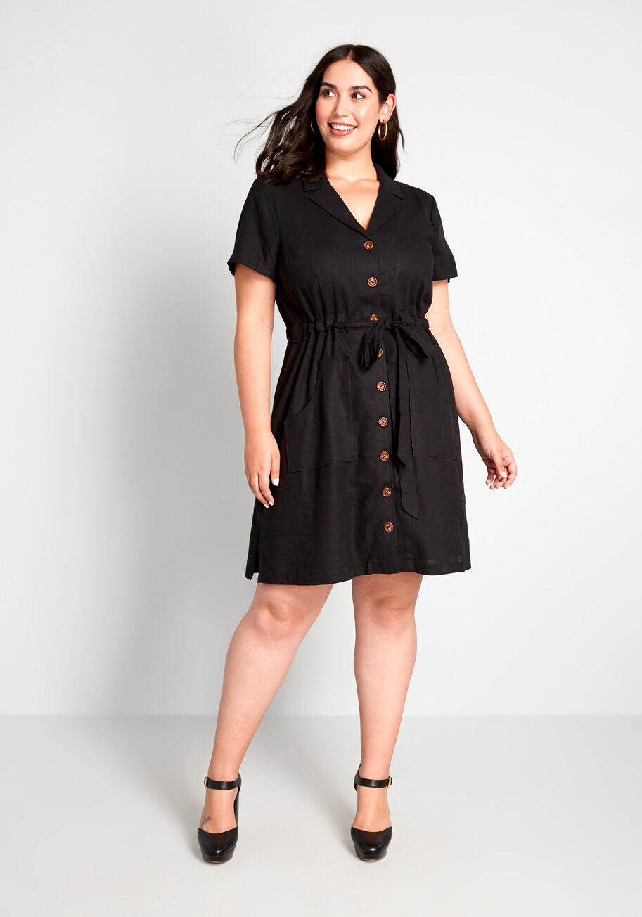 Model wearing woven-fabric shirtdress with marbled buttons down the front, an adjustable tie waist, and pockets