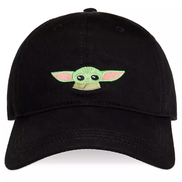 A black baseball cap with the adorable head and shoulders of Baby Yoda embroidered on it